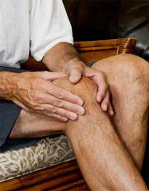 Man massaging his arthritic knee