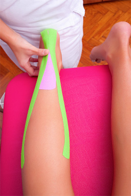 A patents leg has been wrapped with kinesio tape